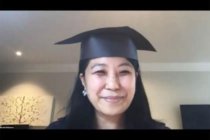 Sociology Department chair wearing a graduation cap and talking on a video chat