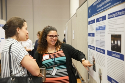 Graduate student Amaris Vazquez presents a poster at Research Days 2017 in the Marvin Center.